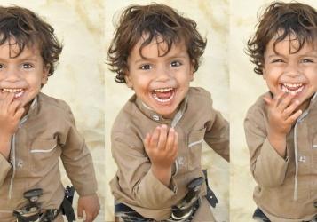 """ملتقط صورة """"الطفل اليمني السعيد"""" يحكي قصتها"""